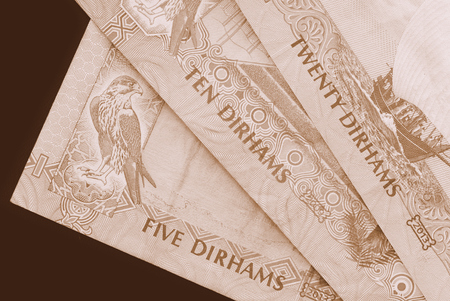 UAE dirham currency background close up. Brown color toned Stock Photo