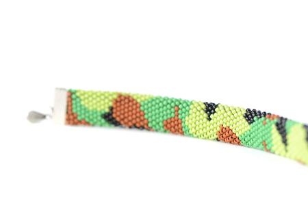 Camouflage beaded bracelet isolated on white background close up