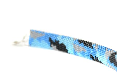 Navy blue camouflage bracelet isolated on white background close up Stock fotó