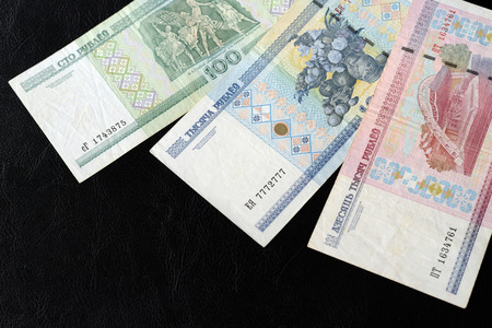 Outdated Belarusian rubles on a dark background close up