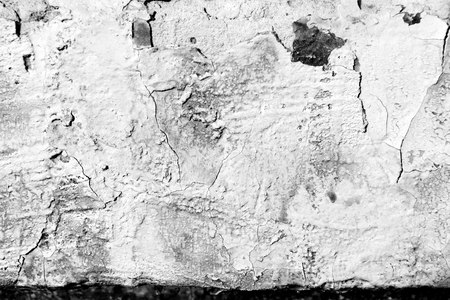 Old painted wall background texture close up. Black and white