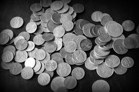 American cents on a dark surface close up. Black and white