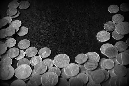 American cents on a dark surface close up. Black and white Stock fotó