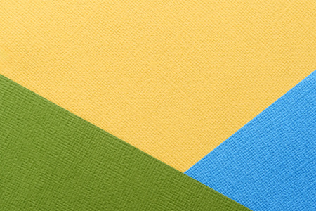 Blue, green, yellow abstract paper background. Paper texture close up