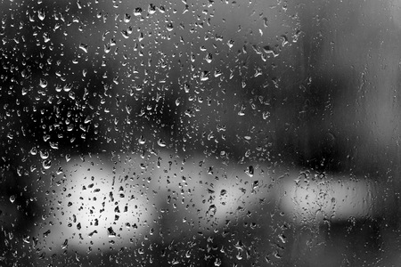 Raindrops on glass in rainy weather close up. Natural background black and white Banco de Imagens - 122987339