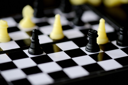 Travel Chess Set on a dark background close up