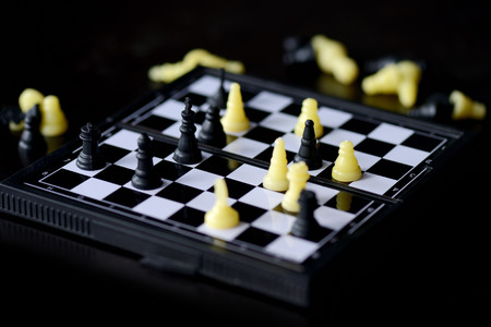 Travel Chess Set on a dark background close up 版權商用圖片