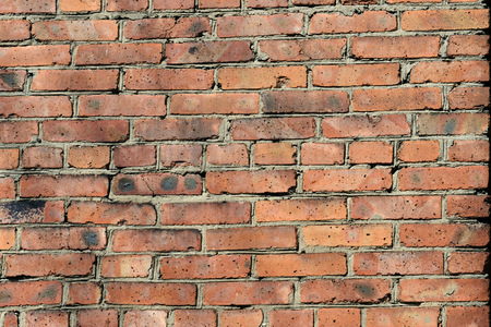 Old red brick wall background. Brick wall texture close up