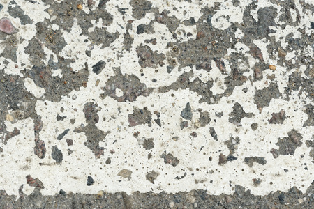 White paint on the old asphalt closeup. Abstract background