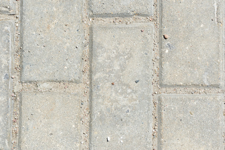 Gray paving slabs texture close up. Paving slabs background