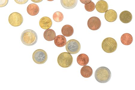 Scattered euro coins isolated on a white background close up Stock Photo