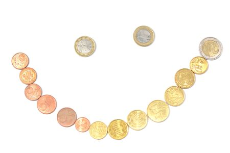 Scattered euro coins in a smile shape isolated on a white background close up Stock Photo
