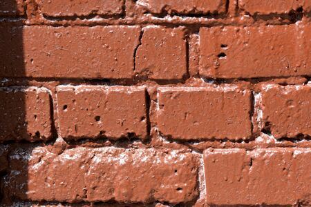 Freshly painted brick wall texture close up. Abstract background