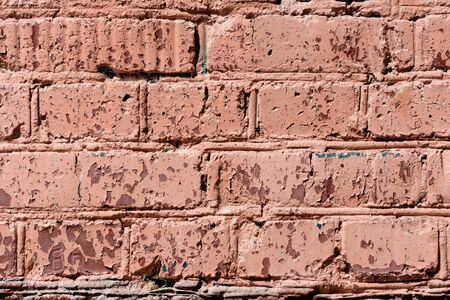 Old brick wall brown color painted texture close up. Abstract background