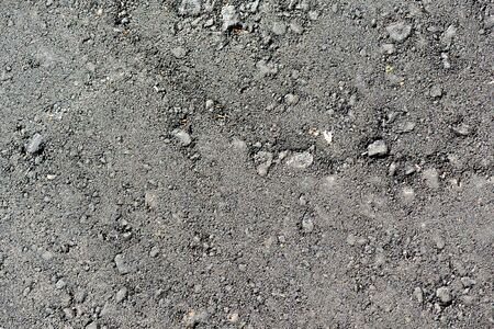 New black asphalt texture close up. Abstract background Imagens