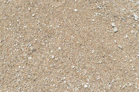 Sand on the coast of the sea close up. Natural abstract background