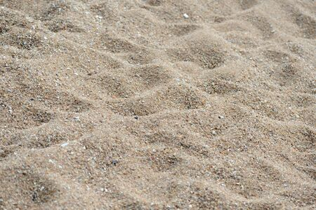 Texture of sand on the beach close up. Natural abstract background