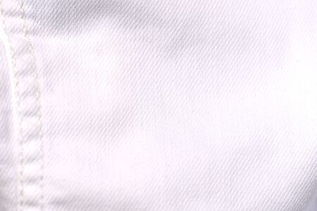 White jeans jacket texture close up. Denim background 写真素材