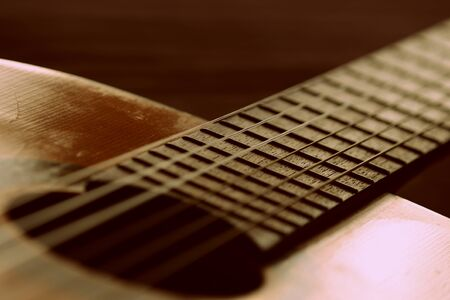 Fragment of an old acoustic guitar close-up
