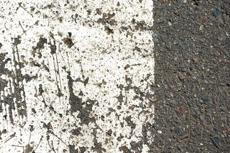 Old dirty asphalt texture with white paint on it. Top view 写真素材