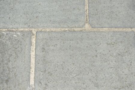 Gray paving slabs closeup, top view. Abstract background