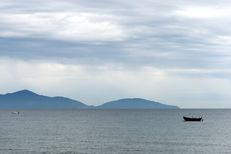Seascape with a view of the boats and the Cham Islands. Hoi An, Vietnam