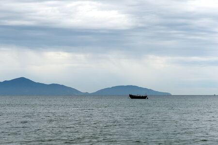 Seascape with a view of the boats and the Cham Islands. Hoi An, Vietnam Zdjęcie Seryjne - 129463799