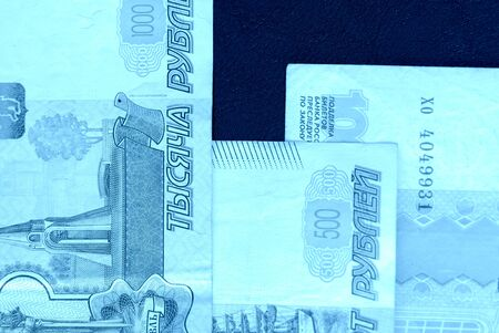 Banknote background from Russian rubles close up. Blue color toned