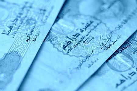 United Arab Emirates banknotes close up blue color toned