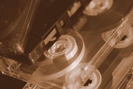 Old audio cassettes on a dark background close up. Retro style