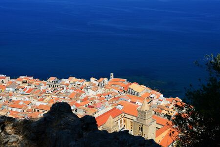 Aerial view of Cefalu town from the rock of Rocca di Cefalu. Sicily, Italy