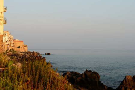 Beautiful seascape off the coast of Cefalu in the early morning. Sicily, Italy Banco de Imagens - 131286779