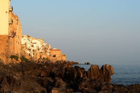 Beautiful seascape off the coast of Cefalu in the early morning. Sicily, Italy Banco de Imagens - 131286882