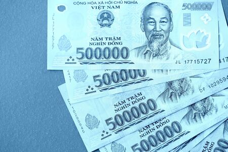 Five hundred thousand vietnamese dongs close up. Money background blue color toned