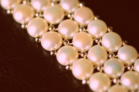 White pearl necklace on a dark background close-up, retro style Banco de Imagens