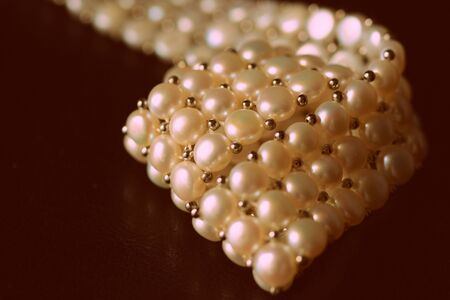 White pearl necklace on a dark background close-up, retro style Foto de archivo