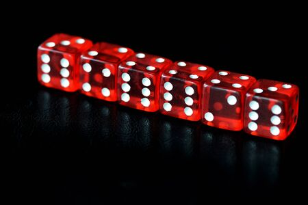 Red dice on a black background close-up. Gambling �oncept