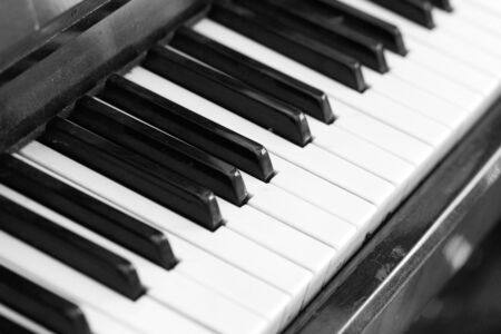 The keys of an old piano close up. Musical background black and white Reklamní fotografie