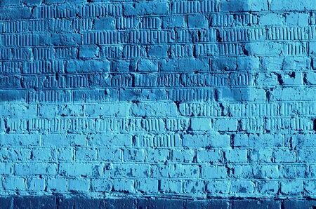 Textura de pared de ladrillo antiguo de cerca. Fondo abstracto color azul entonado