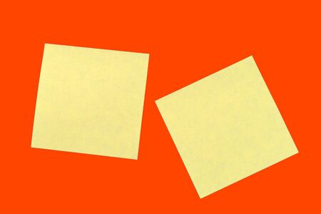Yellow sticker notes on a bright orange red. Business background, copy space