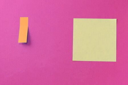 Sticker notes on a bright pink background. Top view, copy space. Business concept, horizontal mock-up Banco de Imagens
