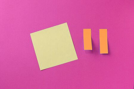 Sticker notes on a bright pink background. Top view, copy space. Business concept, horizontal mock-up 版權商用圖片