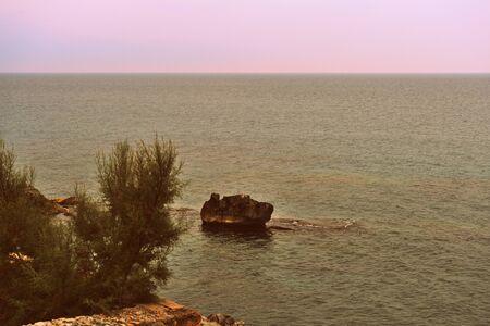 Mediterranean seascape near the city of Cefalu on the Sicily island, Italy. Retro style toned Stockfoto