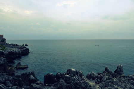 Morning seascape near Cefalu town on the Sicily, Italy.  Natural toned background Stockfoto