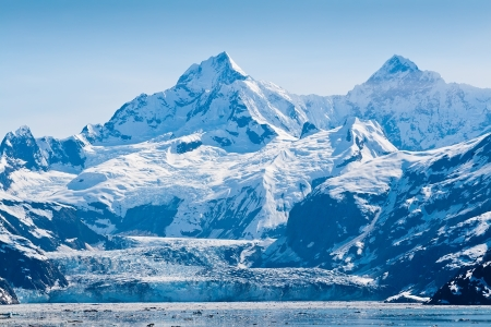 Glacier and snow capped mountains in the Glacier Bay National Park, Alaska Stock Photo