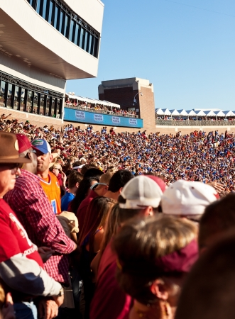 Tallahassee, Florida - Nov. 24, 2012:  FSU fan and UF fan at the Florida State University vs University of Florida college rivalry game at Doak Campbell Stadium in Tallahassee, Florida.