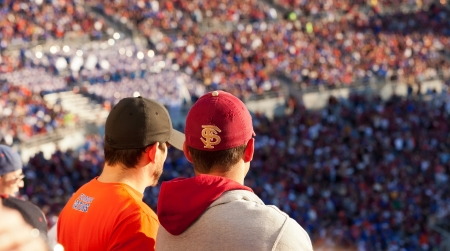 rivalry: Tallahassee, Florida - Nov. 24, 2012:  FSU fan and UF fan at the Florida State University vs University of Florida college rivalry game at Doak Campbell Stadium in Tallahassee, Florida. Editorial