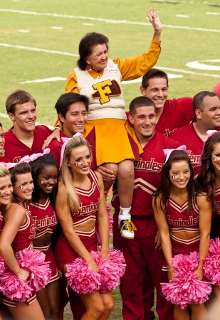 Tallahassee, Florida - October 27, 2012:  The Florida State cheerleading squad welcomes a past member during Homecoming at Doak Campbell Stadium. Stock Photo - 16817614