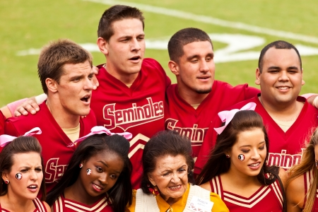 alumni: Tallahassee, Florida - October 27, 2012:  The Florida State cheerleading squad welcomes a past member during Homecoming at Doak Campbell Stadium.