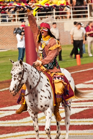 Tallahassee, Florida - October 27, 2012:  Chief Osceola, riding Renegade, gets the crowd going prior to the football game between Florida State Seminoles and Duke University at Doak Campbell Stadium in Tallahassee, Florida.